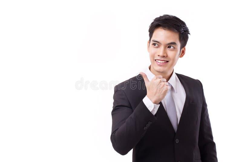 Affärsman som ger upp tummen, pekar och ser upp royaltyfri fotografi