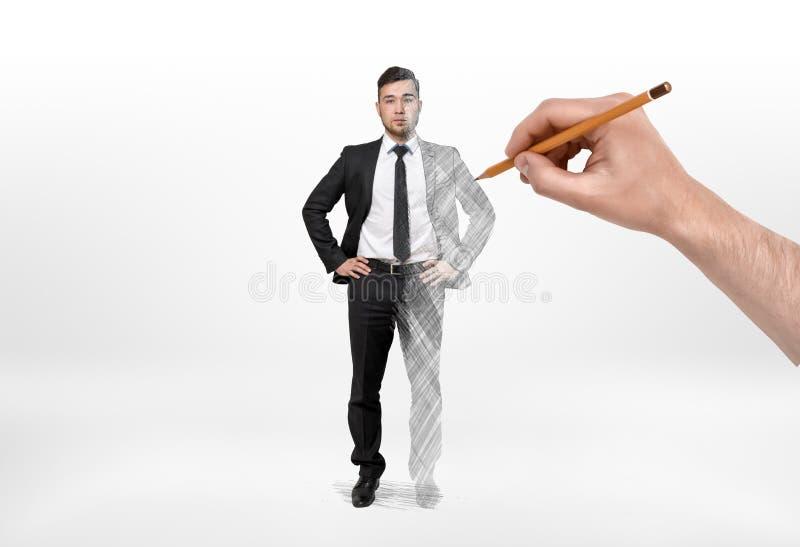 Affärsman som har den vänstra halva verkliga mannen och den högra bilden som drar vid handen arkivbild