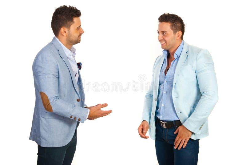 Affärsman som har konversation royaltyfri foto