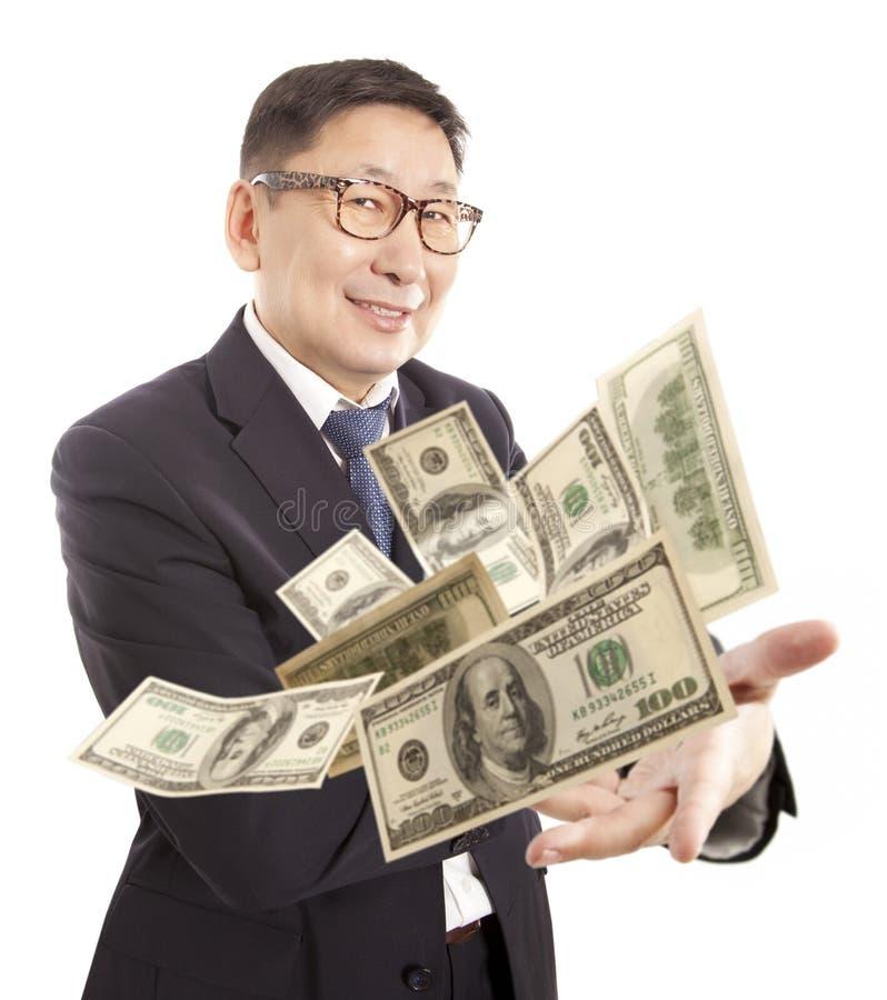 Affärsman som kastar dollaren arkivfoto
