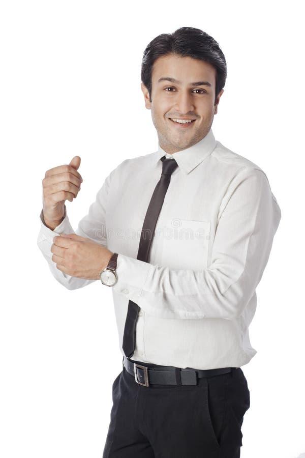 Affärsman som klär upp royaltyfri bild