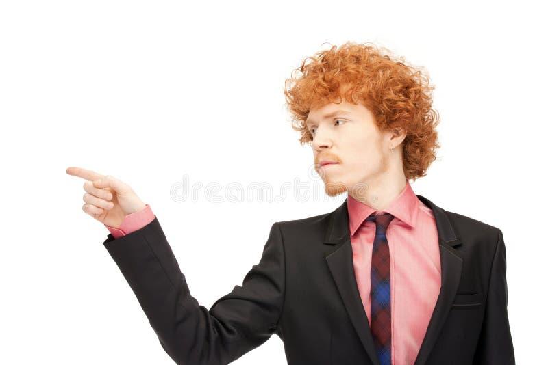 Affärsman som pekar hans finger royaltyfria bilder