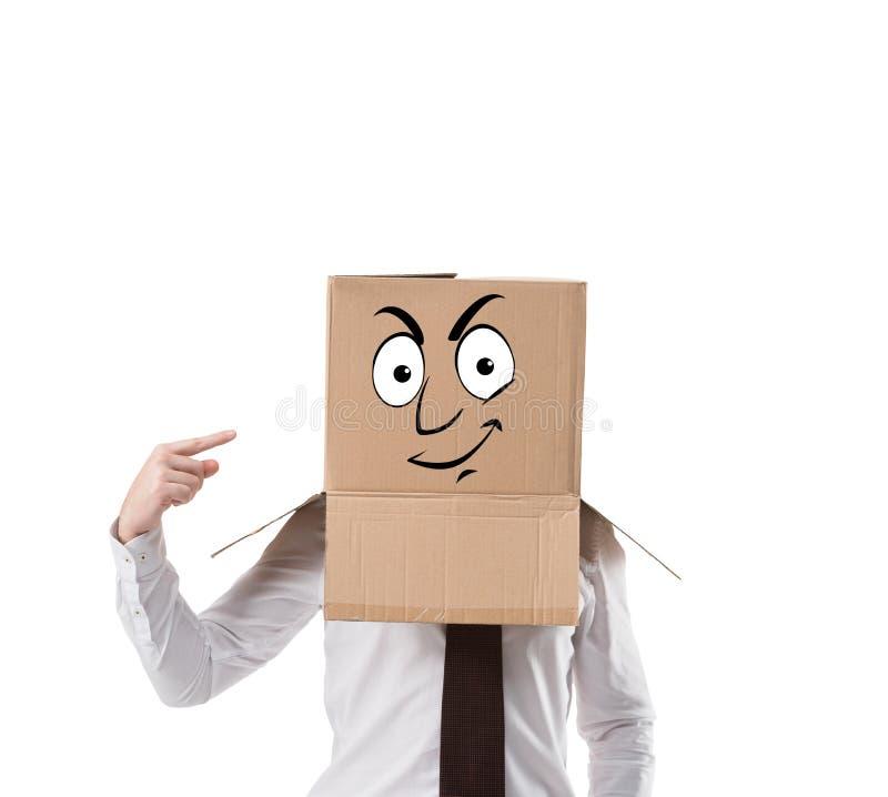 affärsman som pekar på kartongen på hans huvud arkivfoton