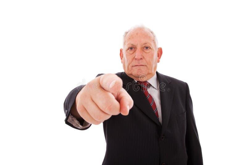 affärsman som pekar pensionären royaltyfri foto