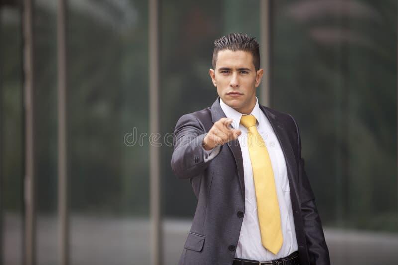 affärsman som pekar till dig royaltyfri bild