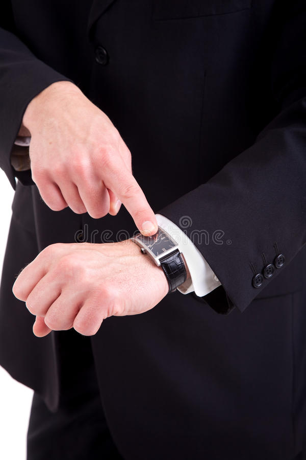 affärsman som pekar till watchen arkivbilder