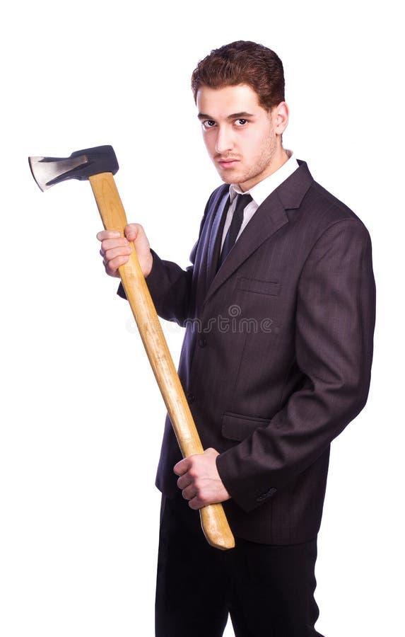 Affärsman som rymmer en yxa arkivbild