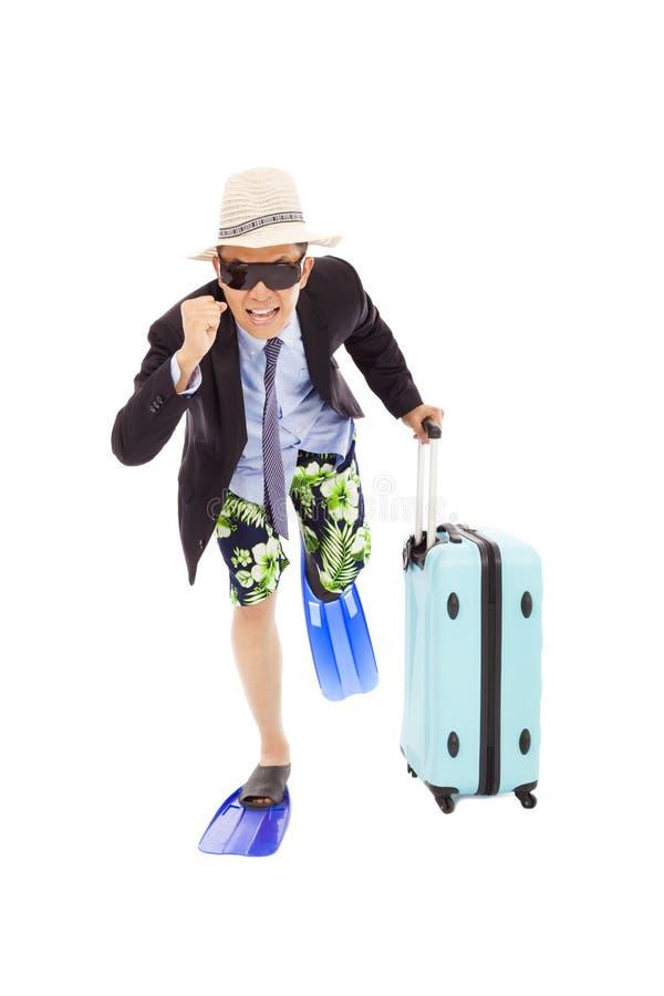 Affärsman som rymmer ett bagage för att köra royaltyfri bild