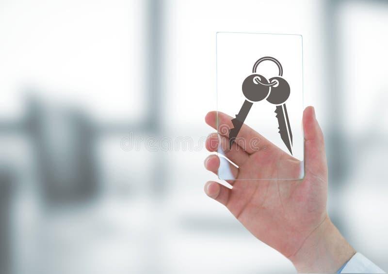 Affärsman som rymmer ett exponeringsglas med tangentsymboler arkivfoto