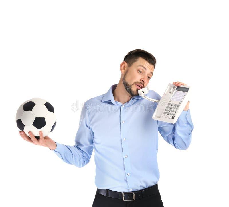 Affärsman som rymmer fotbollbollen, medan tala royaltyfria foton