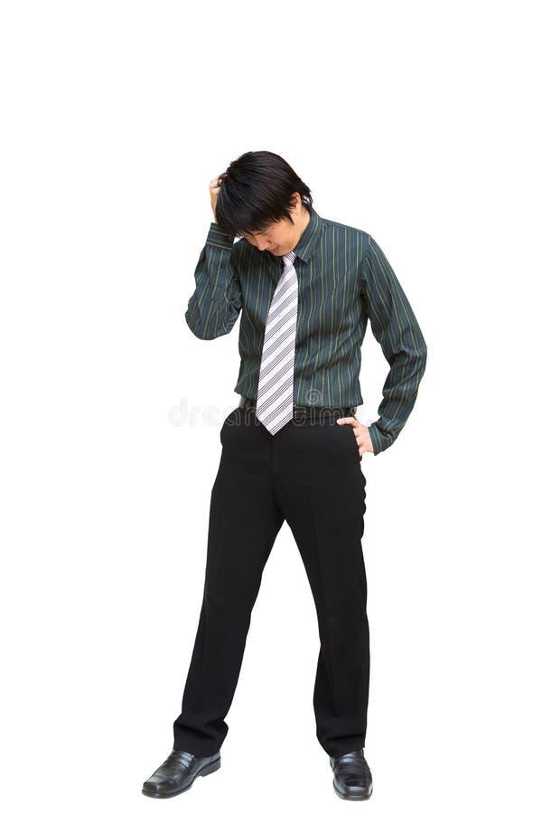 Affärsman som rymmer hans huvud arkivfoto
