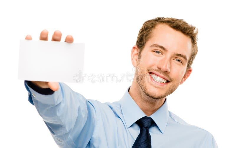 Affärsman som rymmer tomt vitt utrymme för plakatvisningkopia arkivfoton