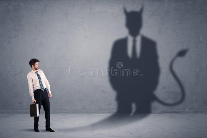Affärsman som ser hans eget begrepp för jäkeldemonskugga royaltyfri foto