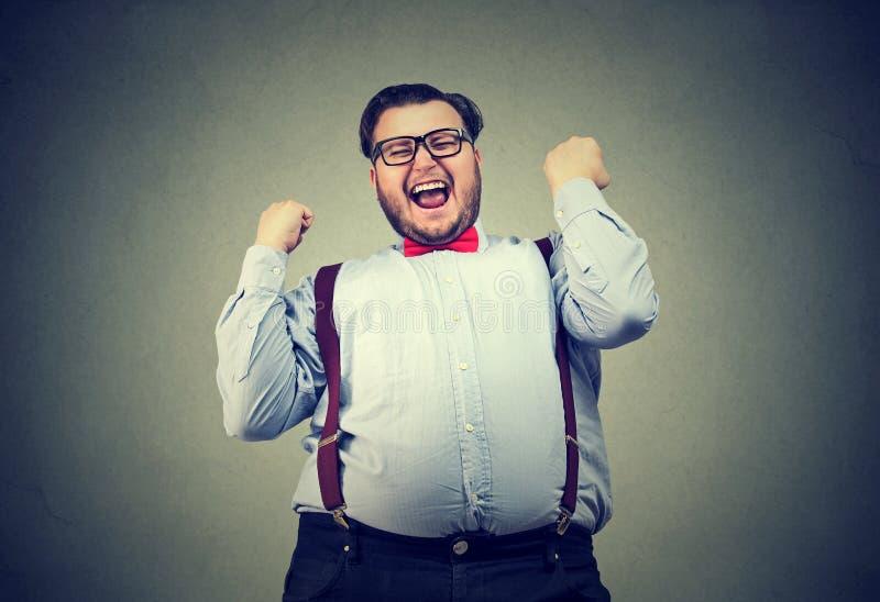 Affärsman som skriker med lycka royaltyfri fotografi
