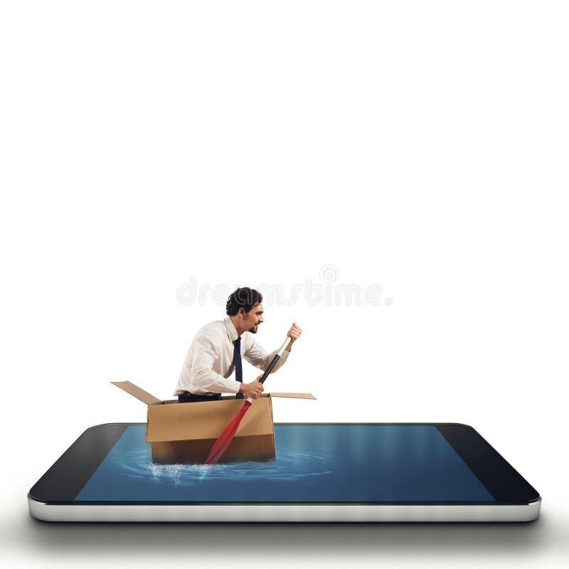 Affärsman som surfar in i en mobiltelefon arkivfoto