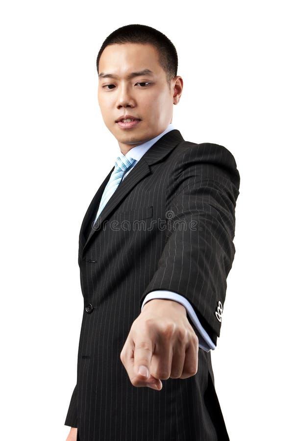 Affärsman som trycker på en imaginär knapp fotografering för bildbyråer