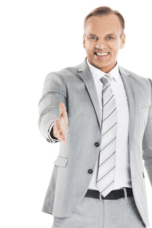 Affärsman som ut sträcker handen för att skaka arkivfoton