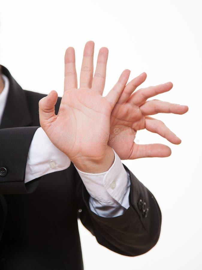 Affärsman som visar att förbjuda av en gest arkivfoto