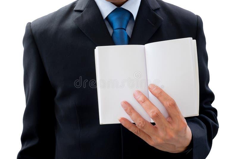 Affärsman som visar den tomma sidan av boken royaltyfria foton