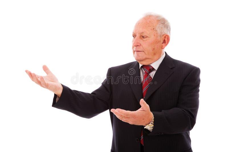 affärsman som visar något royaltyfria bilder
