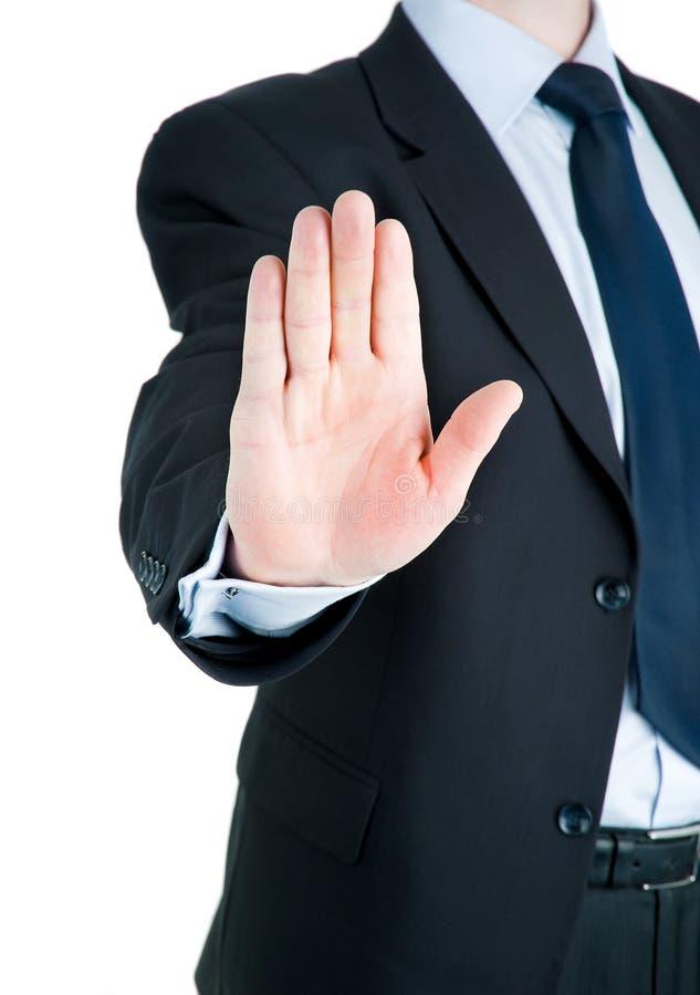 affärsman som visar teckenstoppet royaltyfri fotografi
