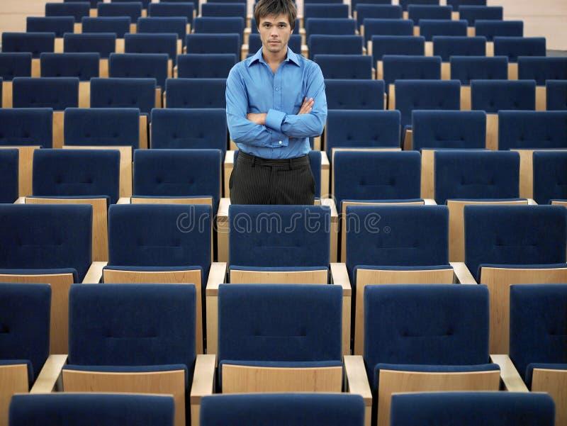 Affärsman Standing In Auditorium royaltyfria foton