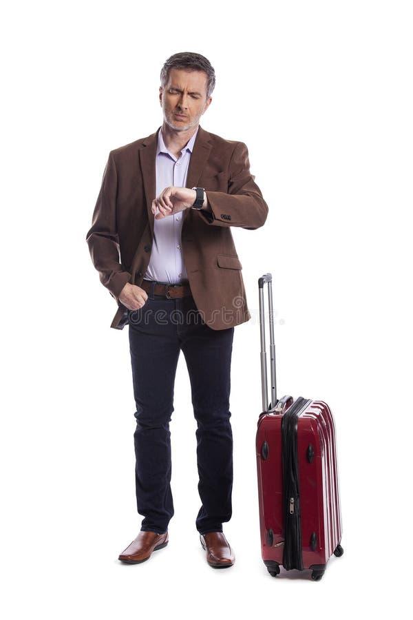 Affärsman Stressed på det sena eller avbrutna flyget för affärstur royaltyfri foto