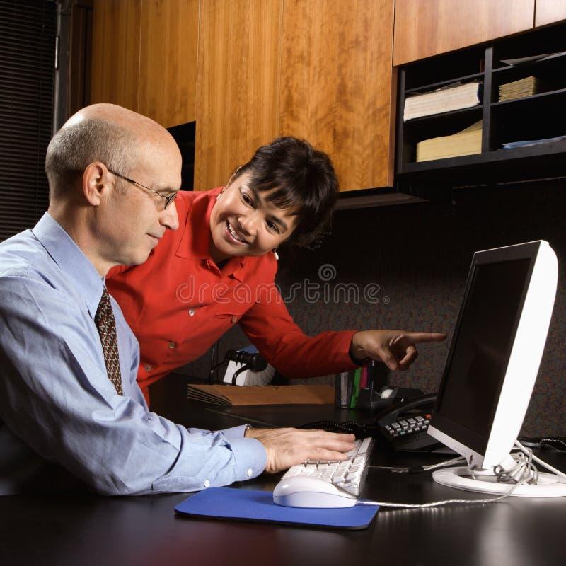 affärsmanaffärskvinna arkivfoton