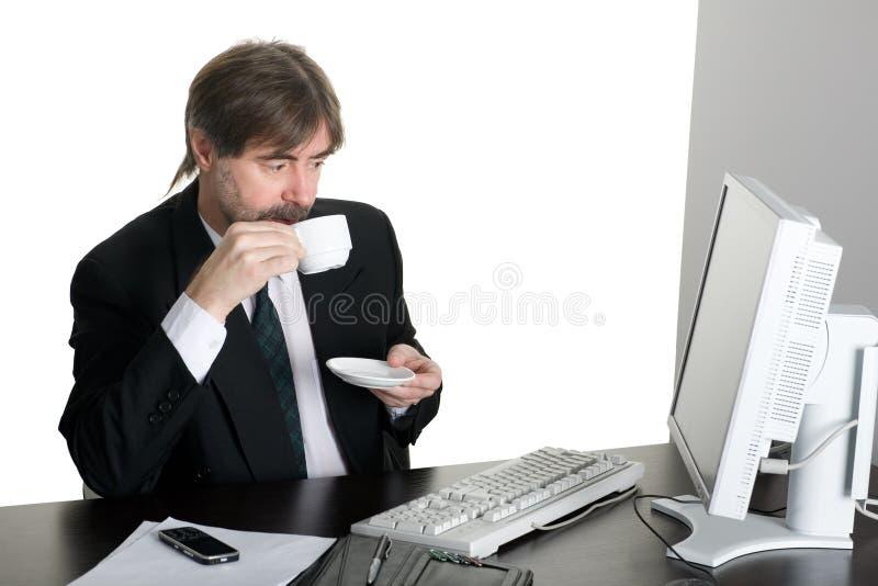 affärsmanarbete arkivfoto