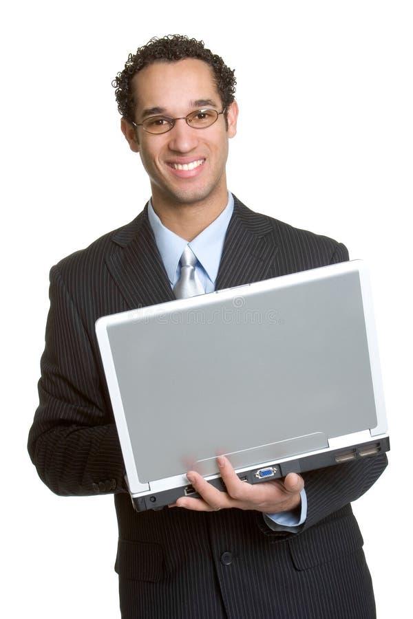 affärsmanbärbar dator arkivbild