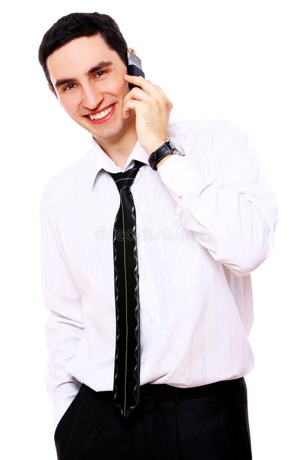 affärsmancelltelefon som ler genom att använda barn arkivfoton