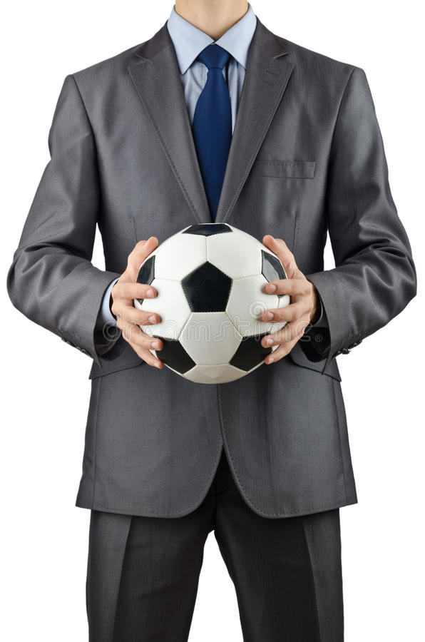 affärsmanfotbollholding arkivfoton