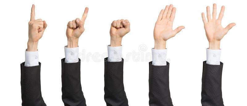 Affärsmanhand i dräkten som visar olika gester arkivbild