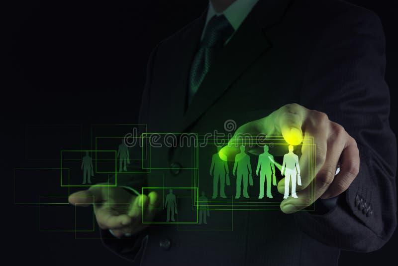 Affärsmanhand som väljer folksymbolen fotografering för bildbyråer