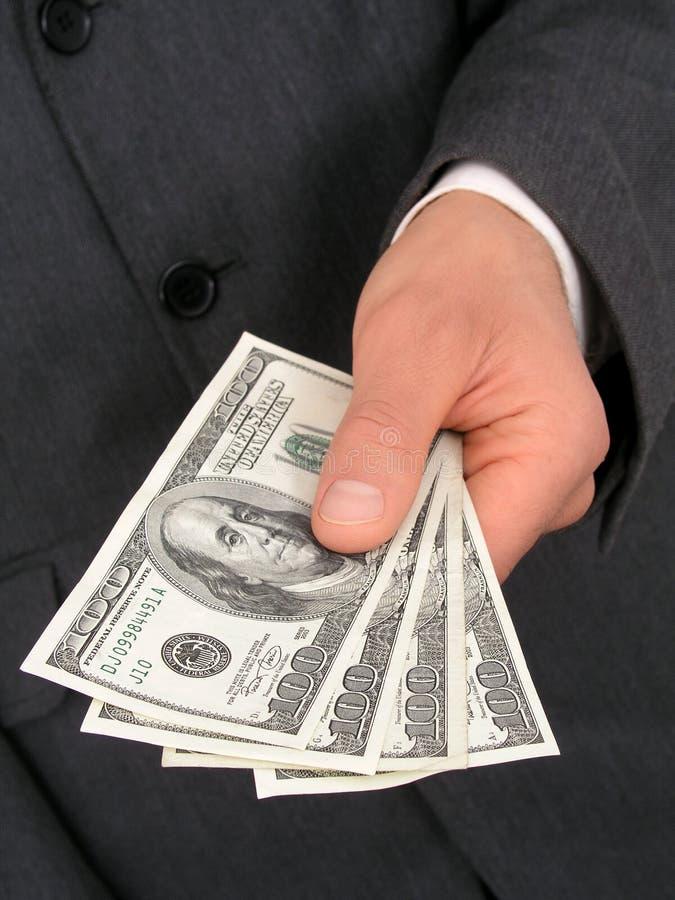 affärsmanhandpengar som erbjuder s royaltyfri bild