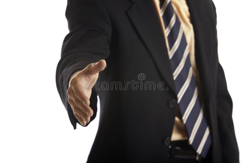 affärsmanhandskakning arkivbild