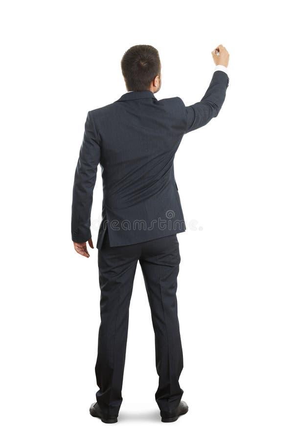 Affärsmanhandstil på den vita väggen royaltyfri foto