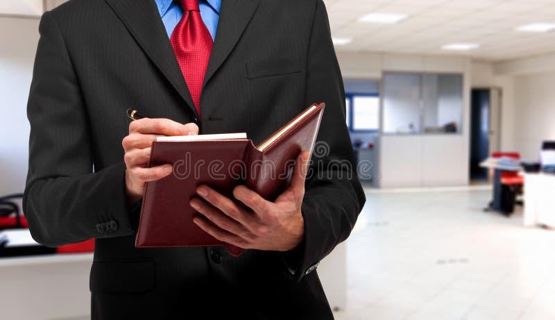Affärsmanhandstil på hans dagordning