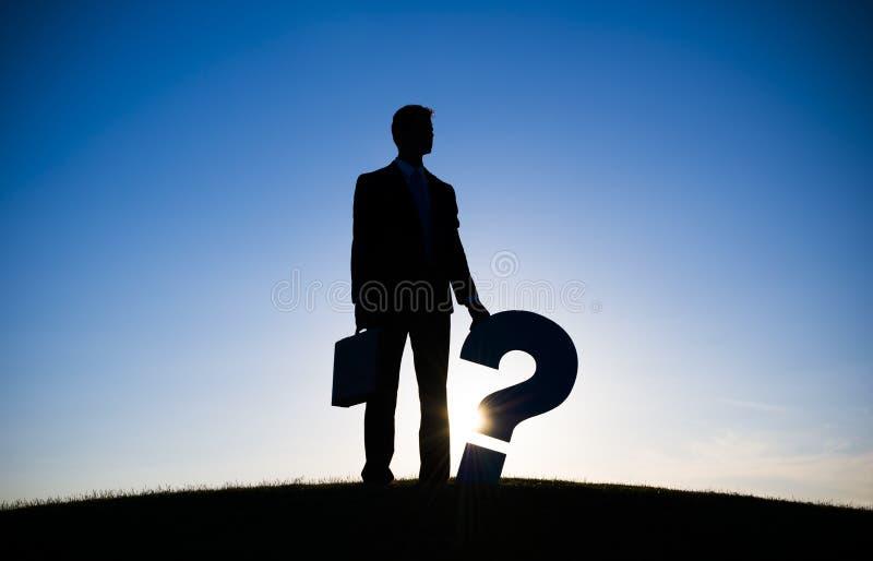AffärsmanHolding Question fläck royaltyfria bilder