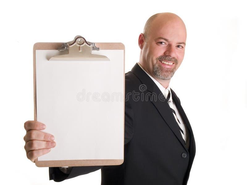 Affärsmanholdingclipboard royaltyfri bild