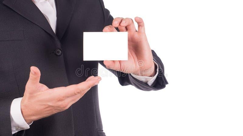 Affärsmaninnehav och tomt affärskort för visning eller känt kort - affärsidé royaltyfria foton