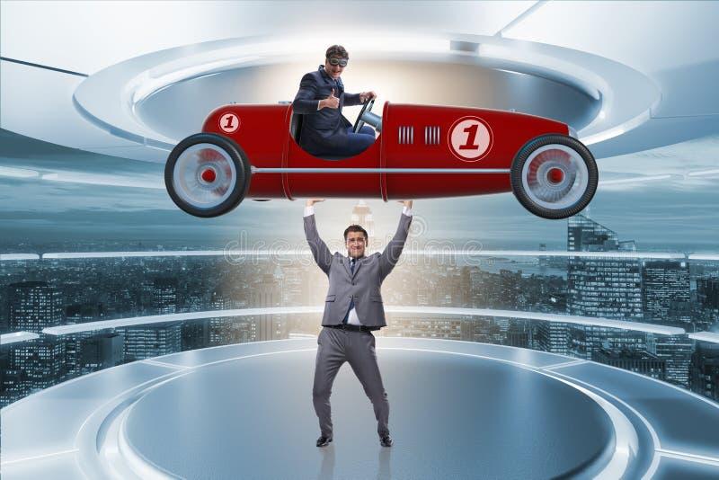 Affärsmanlyftande sportbilen i maktbegrepp arkivfoton