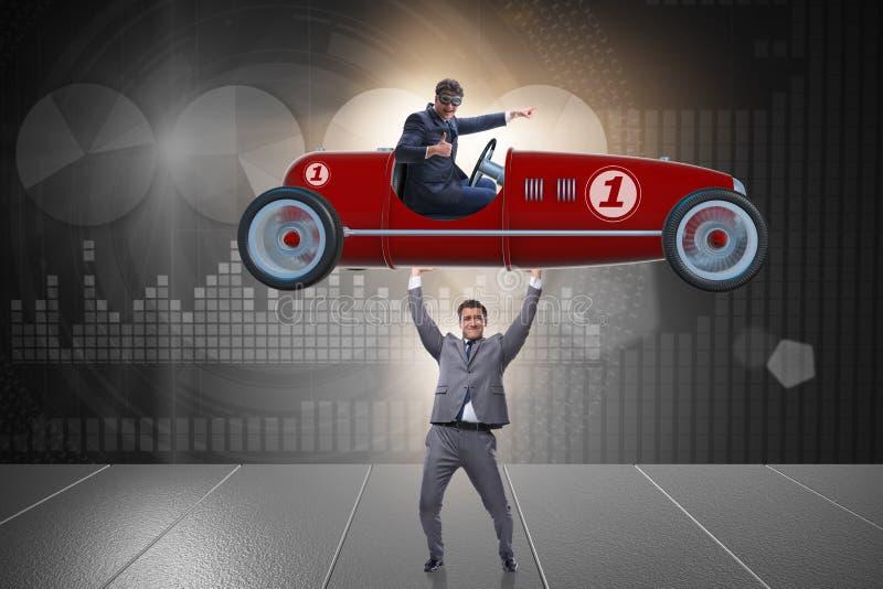 Affärsmanlyftande sportbilen i maktbegrepp arkivbilder