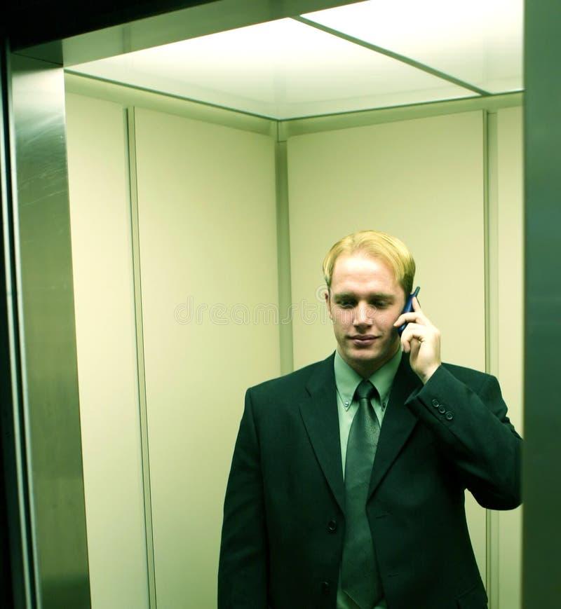 affärsmanmobiltelefon royaltyfria bilder