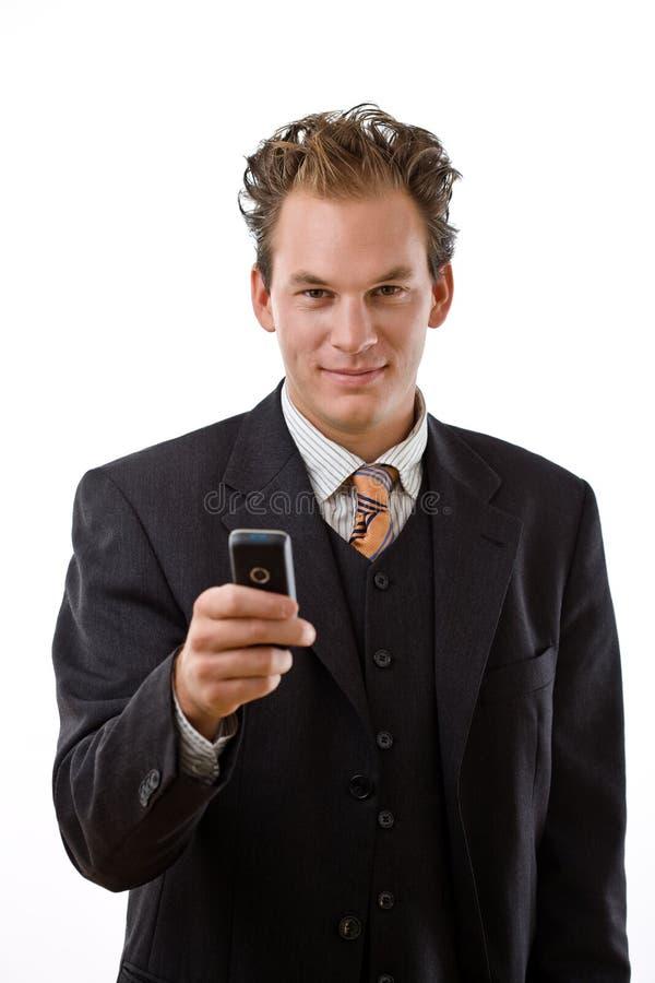 affärsmanmobiltelefon royaltyfri bild