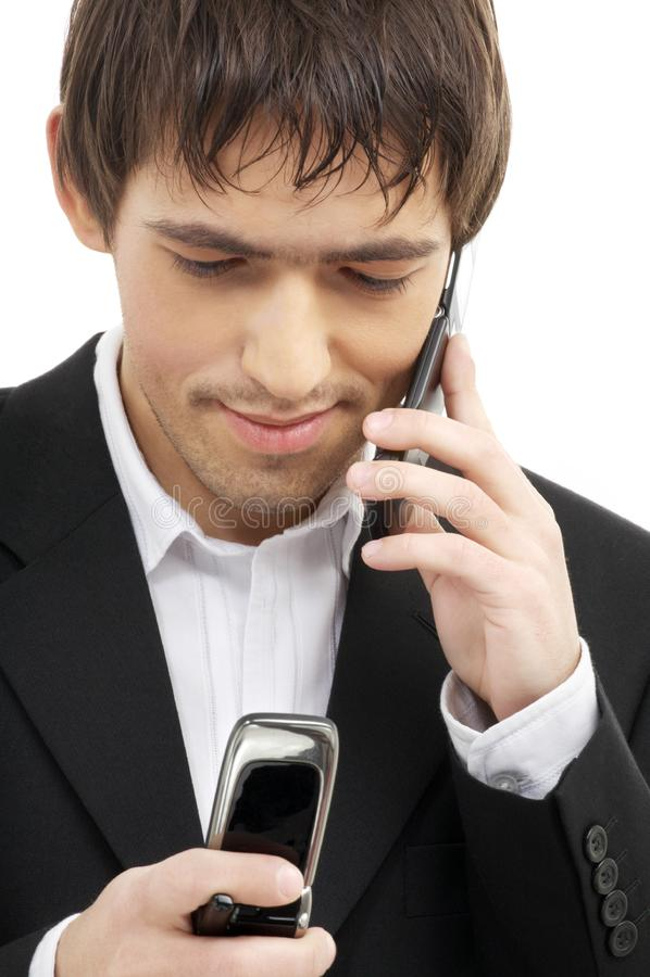 affärsmanmobiltelefoner två royaltyfri foto
