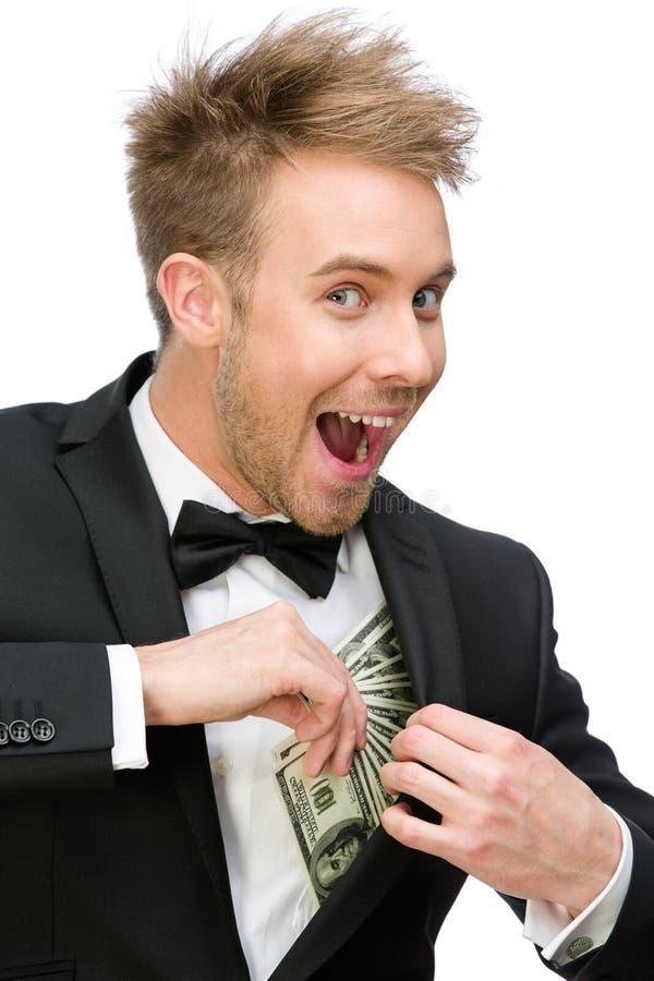Affärsmannederlagpengar royaltyfri foto