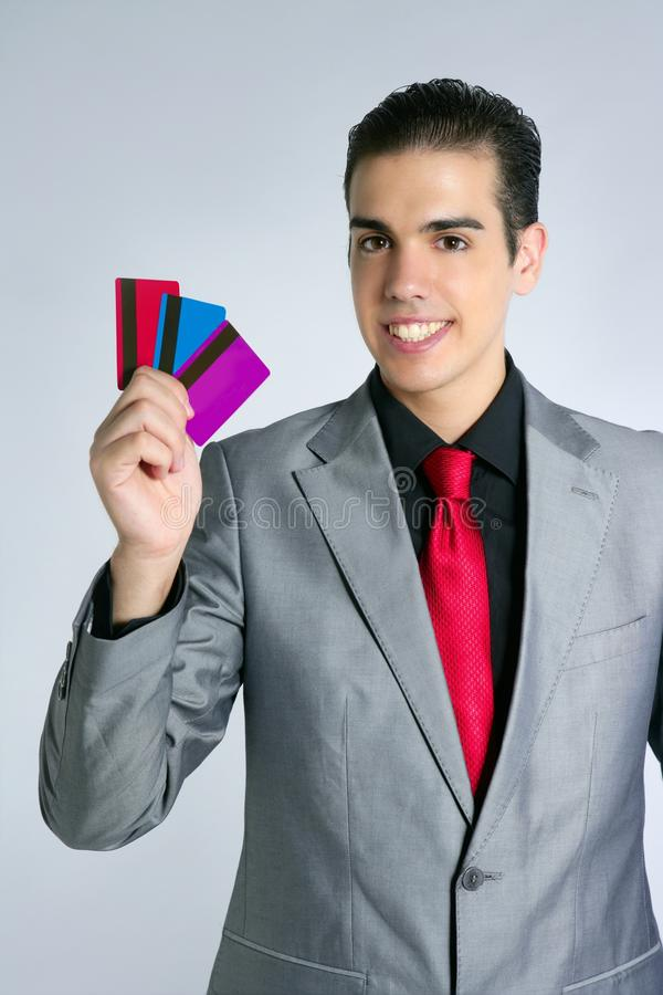 affärsmannen cards barn för kreditering tre royaltyfri foto