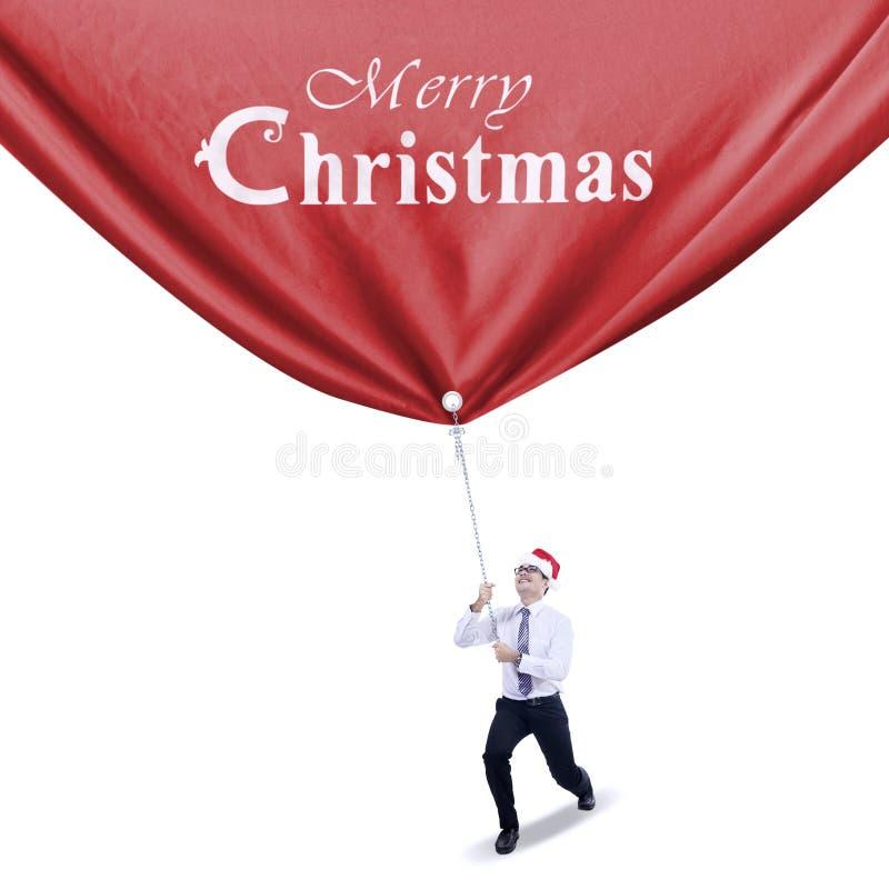 Affärsmannen drar julbanret royaltyfri fotografi