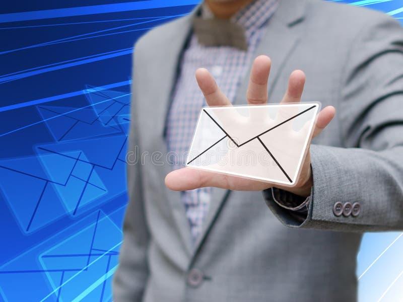 Affärsmannen fångna emailen, kontaktar oss begreppet royaltyfria foton